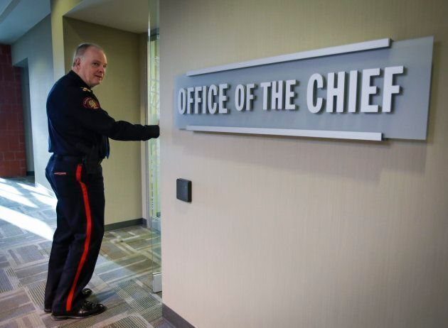Calgary Police Service chief Roger Chaffin enters his office at CPS Headquarters in Calgary in