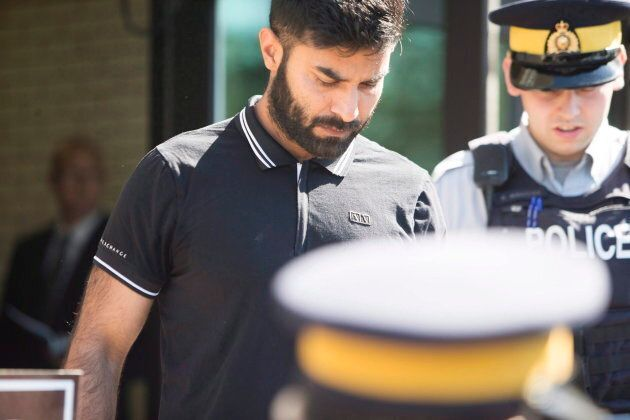 Truck driver Jaskirat Sidhu walks out of provincial court after appearing for charges due to the Humboldt...