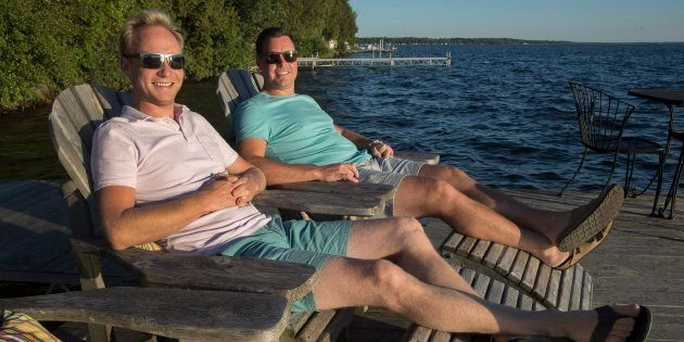 Chris Van Lierop, right, and Tim Wisener are seen at their cottage home on Sturgeon Lake near Fenelon...