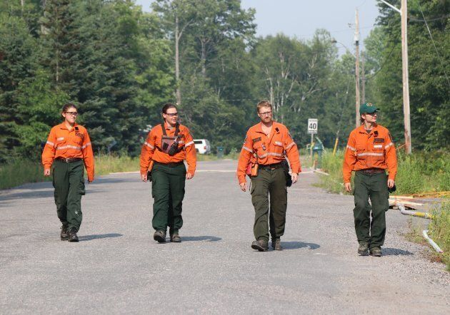 Ontario FireRangers are shown in an area near the fire known as