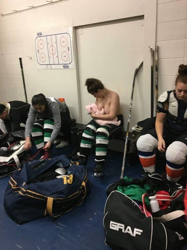 Serah Small breastfeeds her daughter in her hockey locker