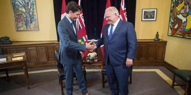 Ontario Premier Doug Ford and Prime Minister Justin Trudeau pose for a photo at the Ontario legislature...
