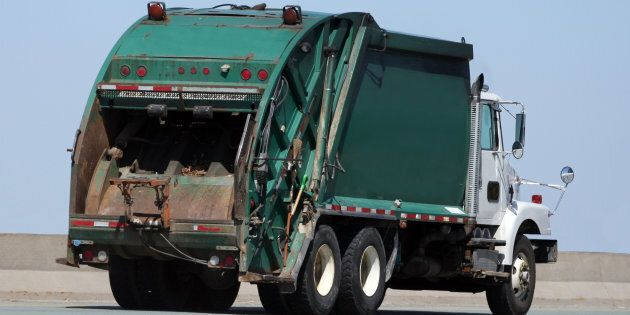 A stock photo of a garbage truck is shown. The driver of the truck in Victoria wasn't hurt but police...
