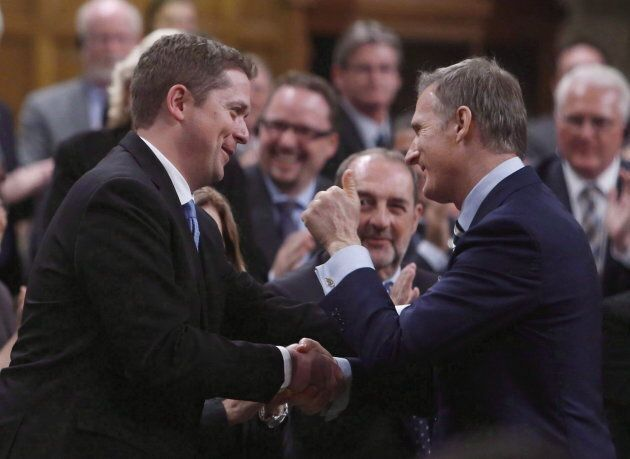 Conservative MP Maxime Bernier (right) gives the thumbs up to Conservative Leader Andrew Scheer in the...