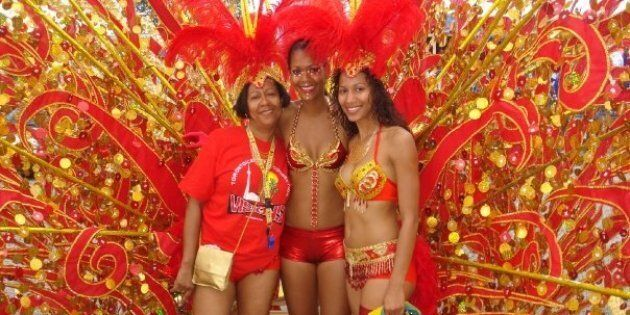 Mother Lou-Ann Crichton with her daughters Joella and Mischka Crichton at the 2008 Toronto Caribbean Carnival parade.