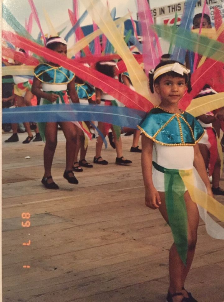 Mischka Crichton at age three playing mas at the St. Vincent Carnival in 1989