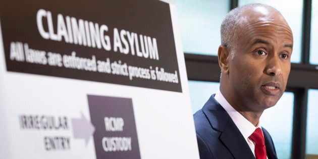 Immigration Minister Ahmed Hussen discusses the situation of irregular migration during a news conference...
