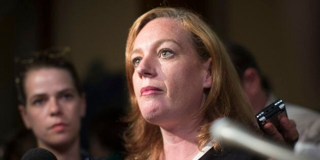 Lisa Macleod, Ontario's Children, Community and Social Services Minister, talks with the media after...