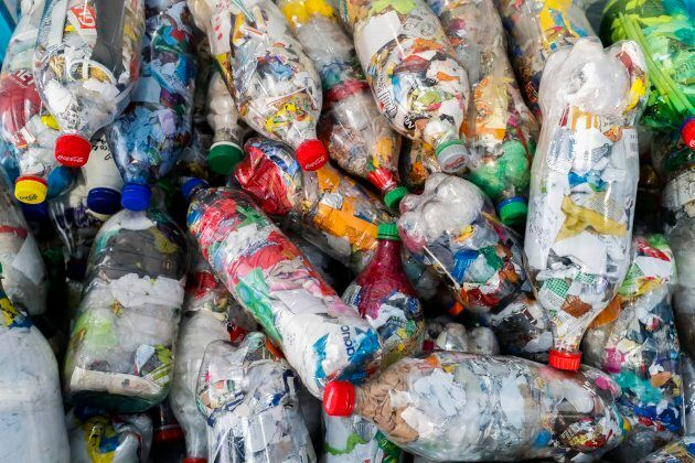 So-called 'Ecobricks' - usually an old plastic bottle filled solid with non-biological waste - are displayed...