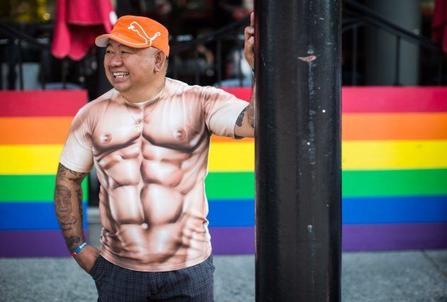 Raffi Rumbaua laughs while waiting for the Pride Parade to begin in Vancouver, on Aug.