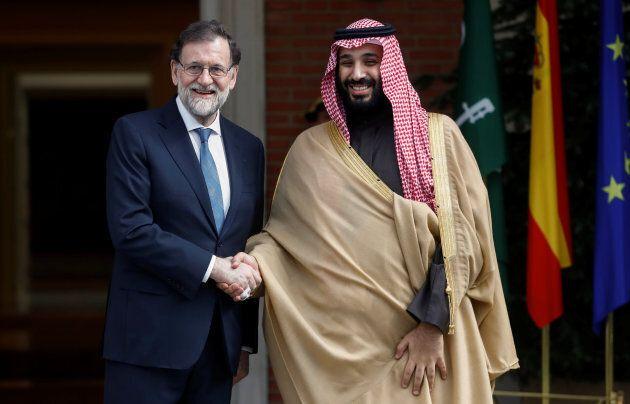 Saudi Arabia's Crown Prince Mohammed bin Salman (R) greets Spain's Prime Minister Mariano Rajoy (L) in Madrid, April 12, 2018.