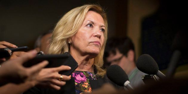 Ontario Deputy Premier Christine Elliott talks with journalists following question period at the Ontario...
