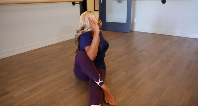 Dr. Liza demonstrates the spinal twist to relieve