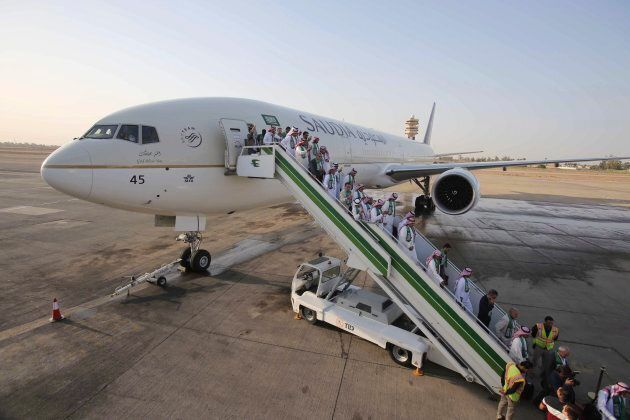 Passengers disembark a Saudi Arabian plane at Baghdad International Airport on Oct. 19,