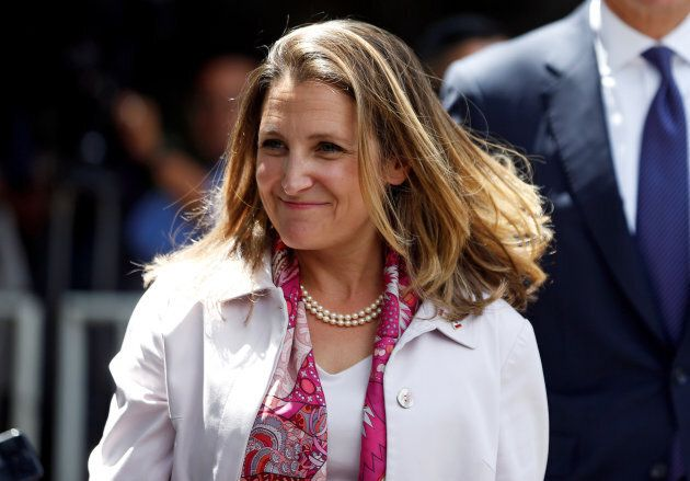 Foreign Minister Chrystia Freeland smiles after a meeting with Mexico's president-elect Andres Manuel...