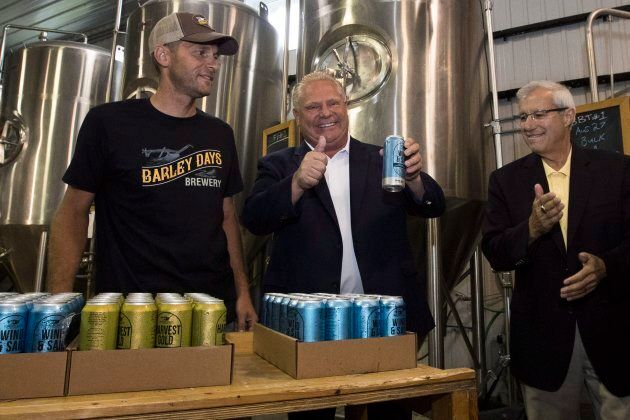 Ontario Premier Doug Ford and Finance Minister Vic Fedeli stack beer with Barley Days employee Kyle Baldwin...