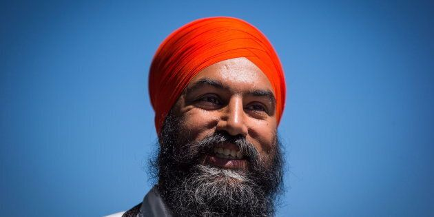 NDP Leader Jagmeet Singh arrives for a news conference in Vancouver on July 13,