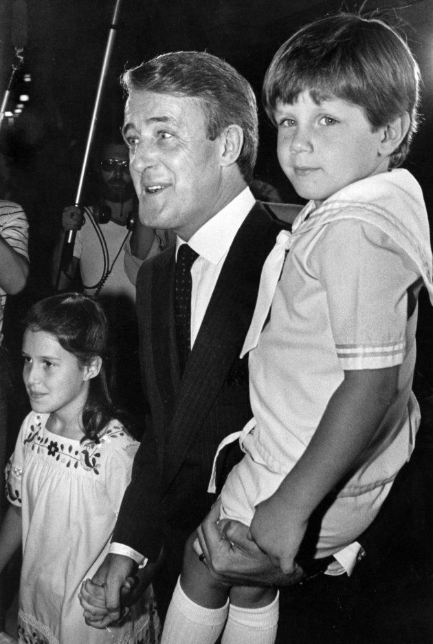 Brian Mulroney carries his son Mark as he makes his way to a swearing-in ceremony with his daughter Caroline...