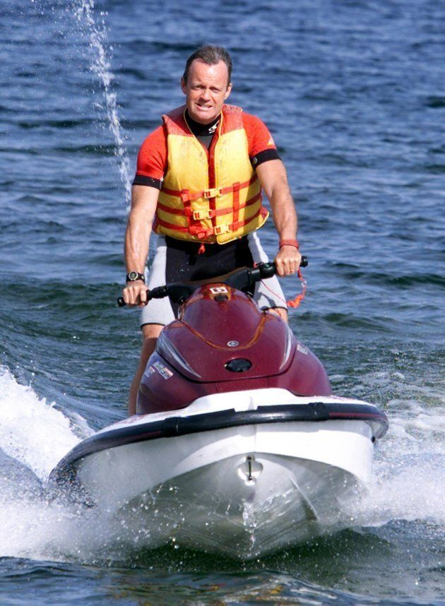 Canadian Alliance leader Stockwell Day arrives at a news conference on a Jet Ski on Okanagan Lake in Penticton, B.C. on Sept. 12, 2000.