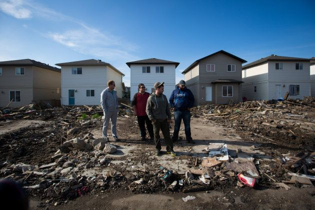 Residents look over the damage in Fort McMurray,