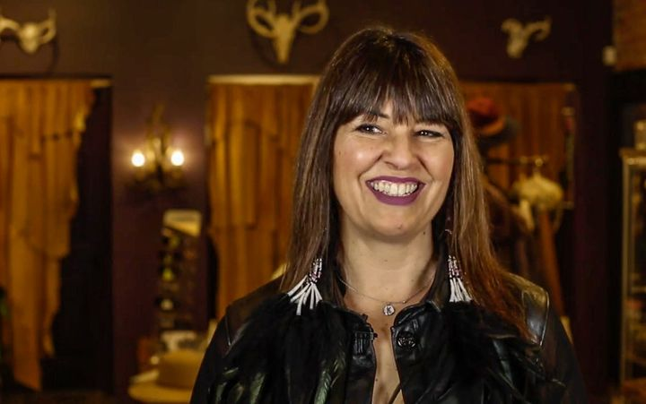 Angela DeMontigny smiles in her store on James St. North in Hamilton, Ont. The designer aims to give Indigenous designers and models more visibility in the fashion industry.