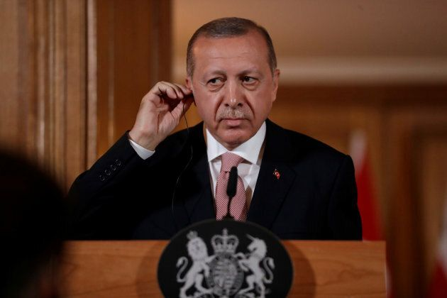 Turkey's president, Recep Tayyip Erdogan, listens during a news conference with British Prime Minister...