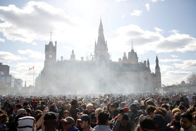 Smoke rises during the annual 4/20 marijuana rally on Parliament Hill in Ottawa on April 20,