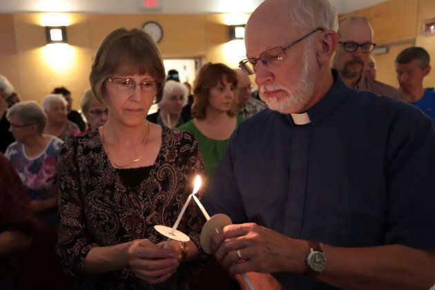 Participants light candles in a vigil for the fallen in Fredericton, New Brunswick on August 10,