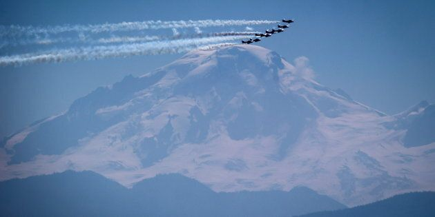 Planes fly past Mount Baker in Washington State before landing at Abbotsford International Airport for...