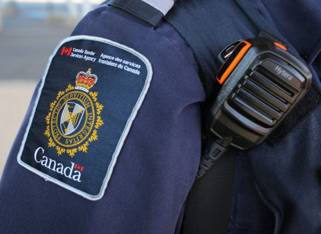 A Canada Border Service Agency officer is seen in Fort Erie, Ontario, on July 5,