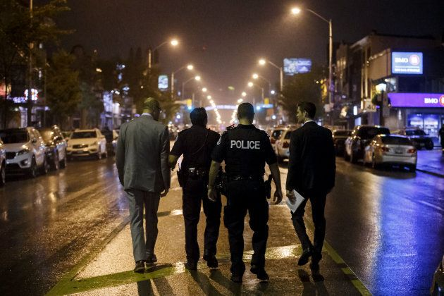 Toronto Police officers at the scene of the fatal mass shooting that claimed two young lives on July...