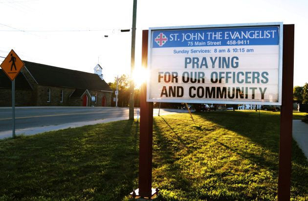 A message at the St. John the Evangelist Anglican Church notifies the community of a prayer vigil after...