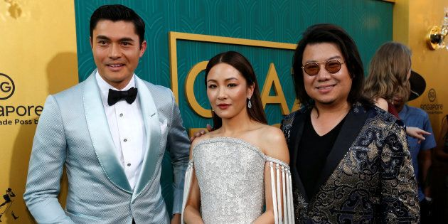 Author Kevin Kwan (R) and cast members Henry Golding and Constance Wu pose at the