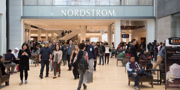 Shoppers at Yorkdale Shopping Centre in Toronto, with a Nordstrom location visible in the background....