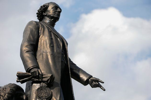 A statue of John A. Macdonald is shown at the south end of Queen's Park in Toronto.