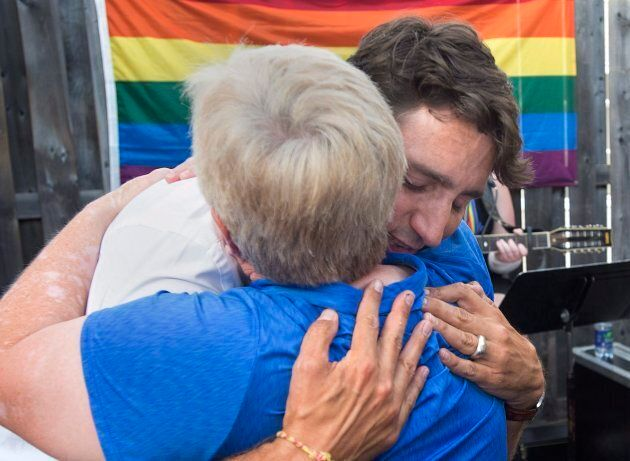 Prime Minister Justin Trudeau embraces a friend as he attends a Fredericton Pride event Aug. 12,