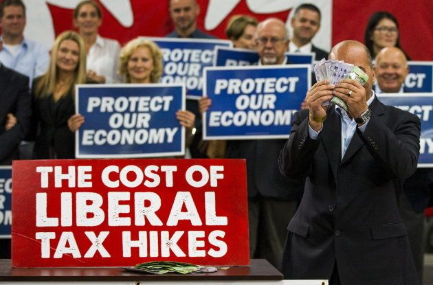 Dino Ari, a local restaurant owner, takes part in a skit as he illustrates how much the Conservatives...