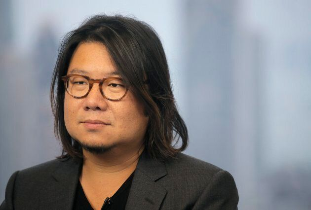 Kevin Kwan listens to a reporter's questions during an interview in Hong Kong.