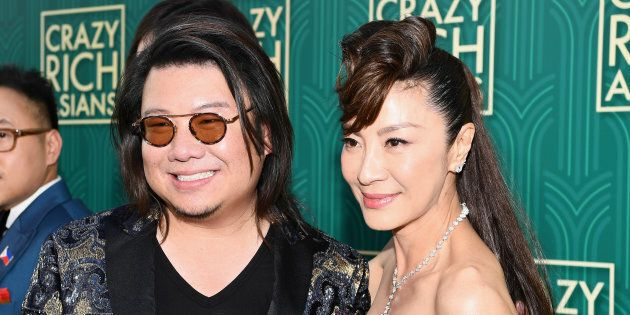 Author Kevin Kwan poses with actor Michelle Yeoh at the 'Crazy Rich Asians' Premiere at TCL Chinese Theatre...