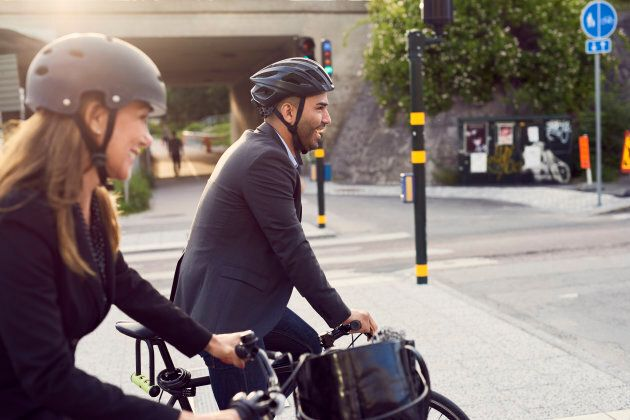 Biking to work with friends increasing happiness levels even more!