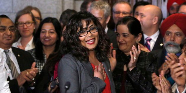 Liberal MP Iqra Khalid is welcomed by her colleagues as she arrives to make an announcement about an...