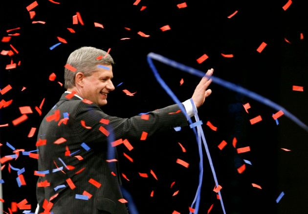 Former prime minister Stephen Harper waves to supporters at his election night headquarters in Calgary...