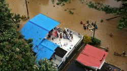 Rescuers Pluck People From Rooftops As Floods Kill Hundreds In