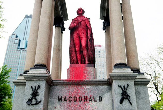 The statue of Sir John A. Macdonald is seen after being vandalized in Montreal on