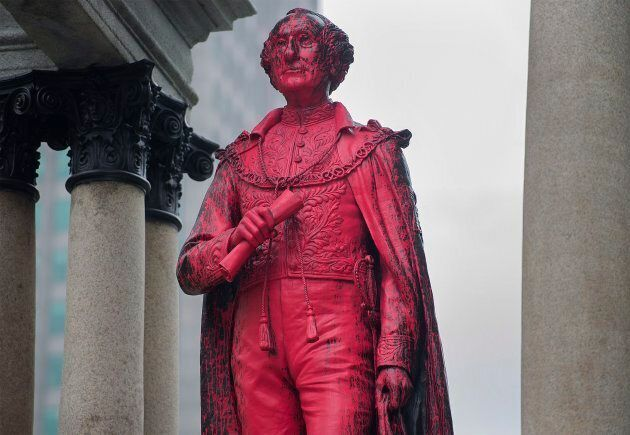 The statue of Sir John A. Macdonald is seen after being vandalized in