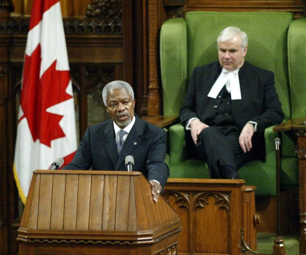 Kofi Annan addresses a joint session of Parliament as Speaker of the House of Commons Peter Milliken...