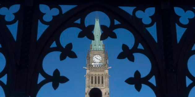 The Peace Tower is framed through a gate on Parliament Hill in Ottawa on Jan. 21,