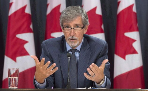 Federal Privacy Commissioner Daniel Therrien responds to a question during a press conference in Ottawa...