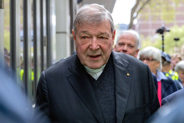 Vatican Treasurer Cardinal George Pell is surrounded by Australian police as he leaves the Melbourne...