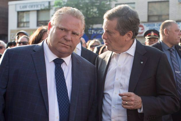Ontario Premier Doug Ford and Toronto Mayor John Tory take part in a candlelit vigil to honour the victims...